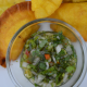 Colombian aji sauce in a container surrounded by empanadas