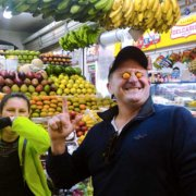 Learn More than Spanish Students visiting one of Bogota's tasting different exotic fruits from Colombia in a local market