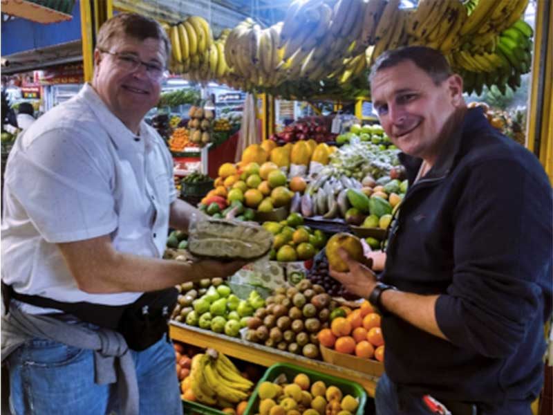 Learn More Than Spanish students visiting one of Bogota's famous local markets