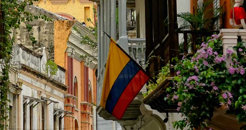 Colombian flag in a window with flowers. Is Colombian Spanish really the world's best?