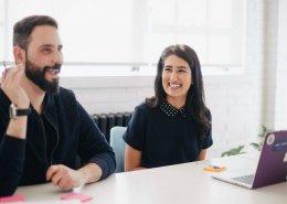 A man and a woman enjoying a class