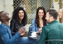 Group of people enjoying coffee outside and having a good time