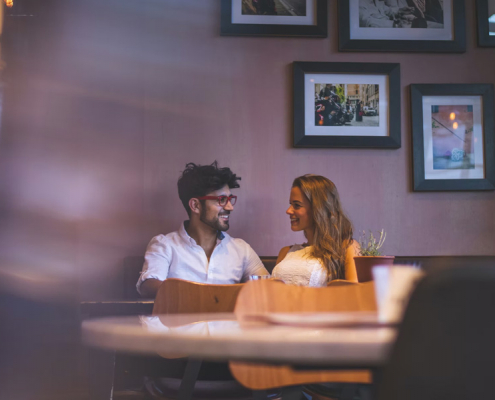 Happy couple in a date at a restaurant.
